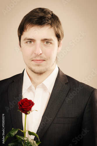 Zdjęcia na płótnie, fototapety, obrazy : Handsome man with rose