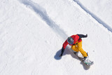 Snowboarder riding on loose snow Freeride
