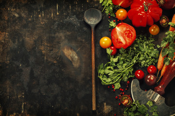 Wooden spoon and ingredients on dark background