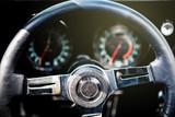 Sports classic car  dashboard. Steering wheel.