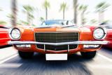 Speeding classic car.