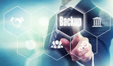 A businessman selecting a Backup Concept button