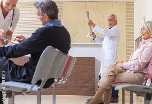 Doctors and patients in hospital waiting room