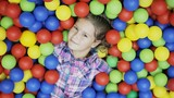 little girl is in the ball pool