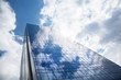 Skyscraper against blue sky - 113924781