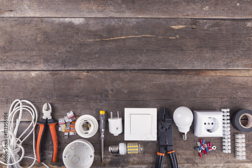 Plakat electrical tools and equipment on wooden background with copy space