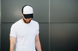 Hipster wearing white blank t-shirt and a cap with space for you