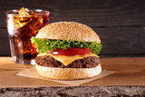 Hamburger, cola drink. Fast food, take away food.