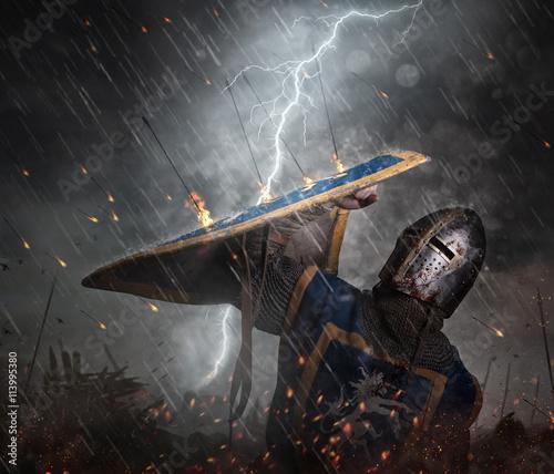 Lightning strikes a knight on battlefield.