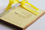 closed yellow vintage notebook for wedding