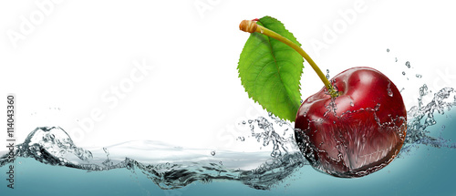 Juicy cherry berry in a spray of cool water.