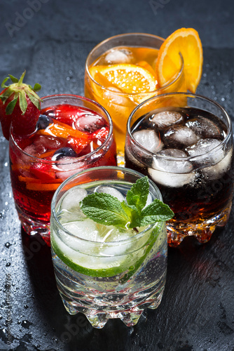 iced fruit drinks on a dark background, top view