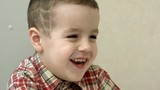 Little boy laughing closeup. Five year old child talking laughing