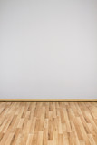 copyspace background with an empty white wall with a hardwood wooden floor