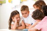 Preschooler and teacher in classroom.