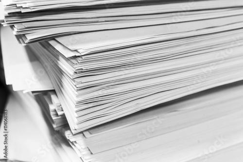 pile of document on desk © notwaew