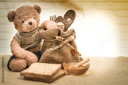 Obraz cup honey on sackcloth with Teddy