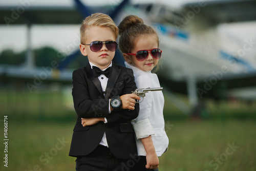 Poster young boy and girl playing spy