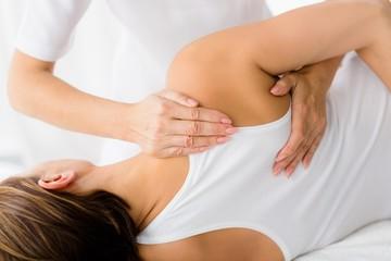Woman receiving massage treatment