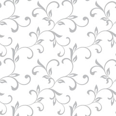 Tender seamless pattern. Tracery of twisted stalks with decorative leaves on a white background. Vintage style. The pattern can be used for printing on textiles, wallpaper, packaging