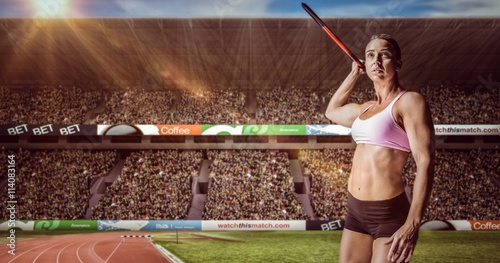 fototapeta na ścianę Composite image of female athlete throwing a javelin