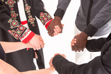 People of different nationalities and religions hold hands. The concept of friendship, communication, teamwork, education, recruitment.
