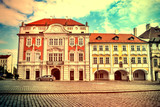 Street in Prague with colorful houses. Vintage view. Old retro style.