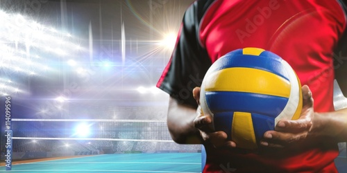 Fototapeta Composite image of mid-section of sportsman holding a volleyball