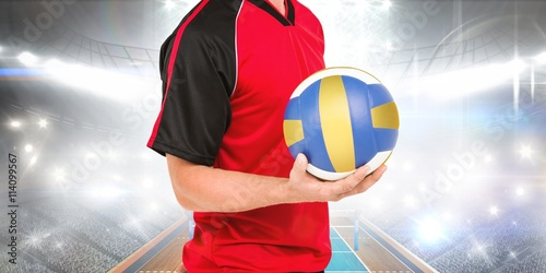 Composite image of sportsman holding a volleyball Poster