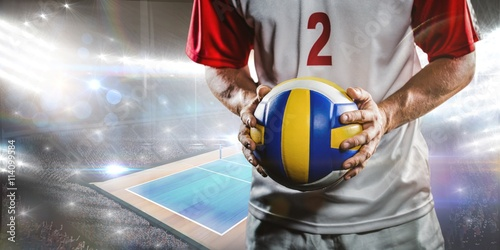 Plakat Composite image of sportsman holding a volleyball