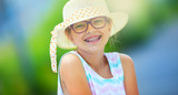 Fototapety Girl.Happy girl teen pre teen. Girl with glasses. Girl with teeth braces. Young cute caucasian blond girl in summer outfit.