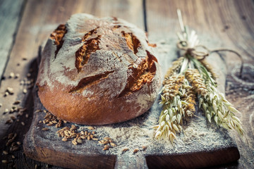 Delicious loaf of bread with wheat