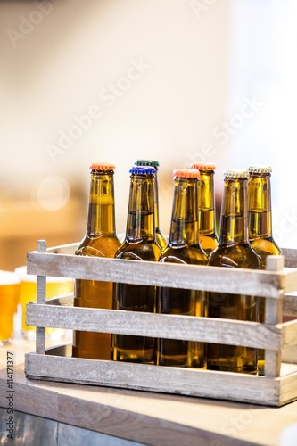 Close-up of beer bottles in crate Poster