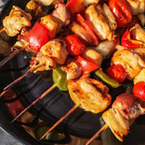 Skewers with grilled meat and vegetables
