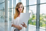 Businesswoman hold some documents