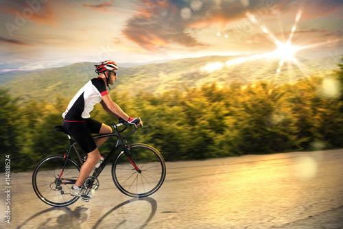 Fototapeta Cyclist at sunset