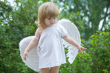 small boy in angel wings