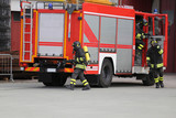 fire engine with many firefighters  for fighting fire