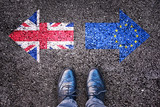 Brexit, flags of the United Kingdom and the European Union on asphalt road with legs - 114210530