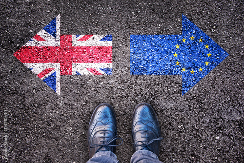 Brexit, flags of the United Kingdom and the European Union on asphalt road with Poster