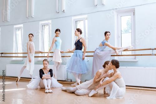 Naklejka The seven ballerinas at ballet bar