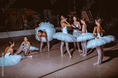 Naklejka The seven ballerinas behind the scenes of theater