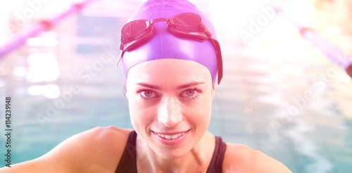 Poster Fit swimmer in the pool smiling at camera