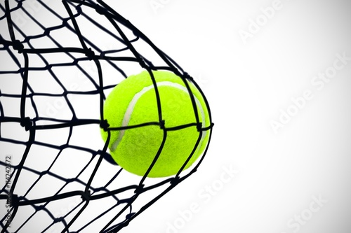 Poster Composite image of tennis ball with a syringe