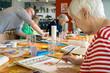 Leinwanddruck Bild - Woman working on watercolor painting.