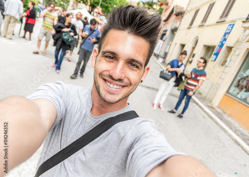 Handsome tourist taking a selfie Poster