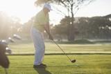 Full length of mature golfer standing on field
