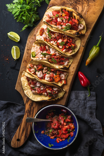 Shrimp tacos with homemade salsa, limes and parsley Plakát