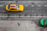 Fototapety View of from above of urban street in New York City Manhattan with yellow taxi cab and car