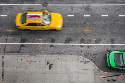 Papiers peints New York TAXI View of from above of urban street in New York City Manhattan with yellow taxi cab and car